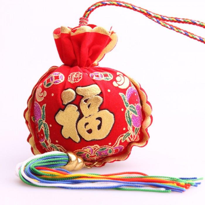 Porte-bonheur sac d'or rond Bonheur général