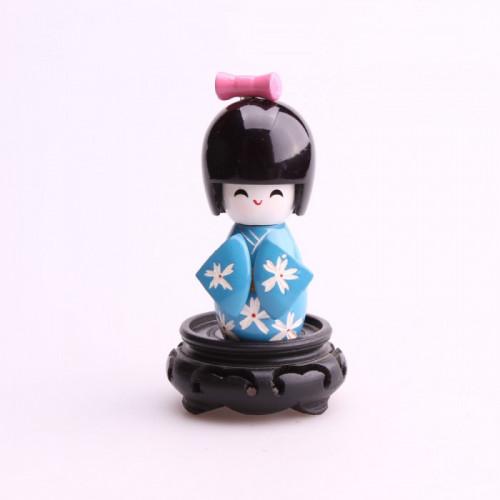 Petite poupée kokeshi bleu fleurs blanches de chrysanthème
